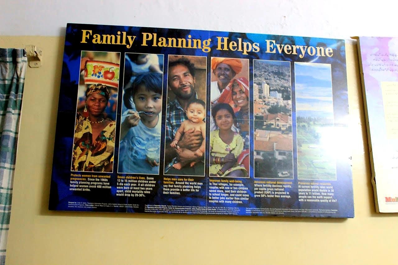 A Poster at the Hospital explains the benefits of Family Planning and shows healthy children.
