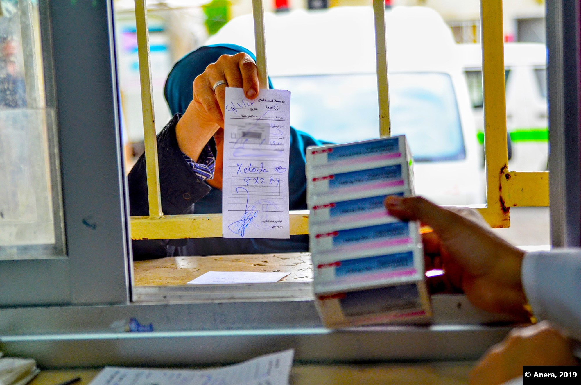Woman filling prescription. Donations of cancer and heart medicines help many people in Gaza.