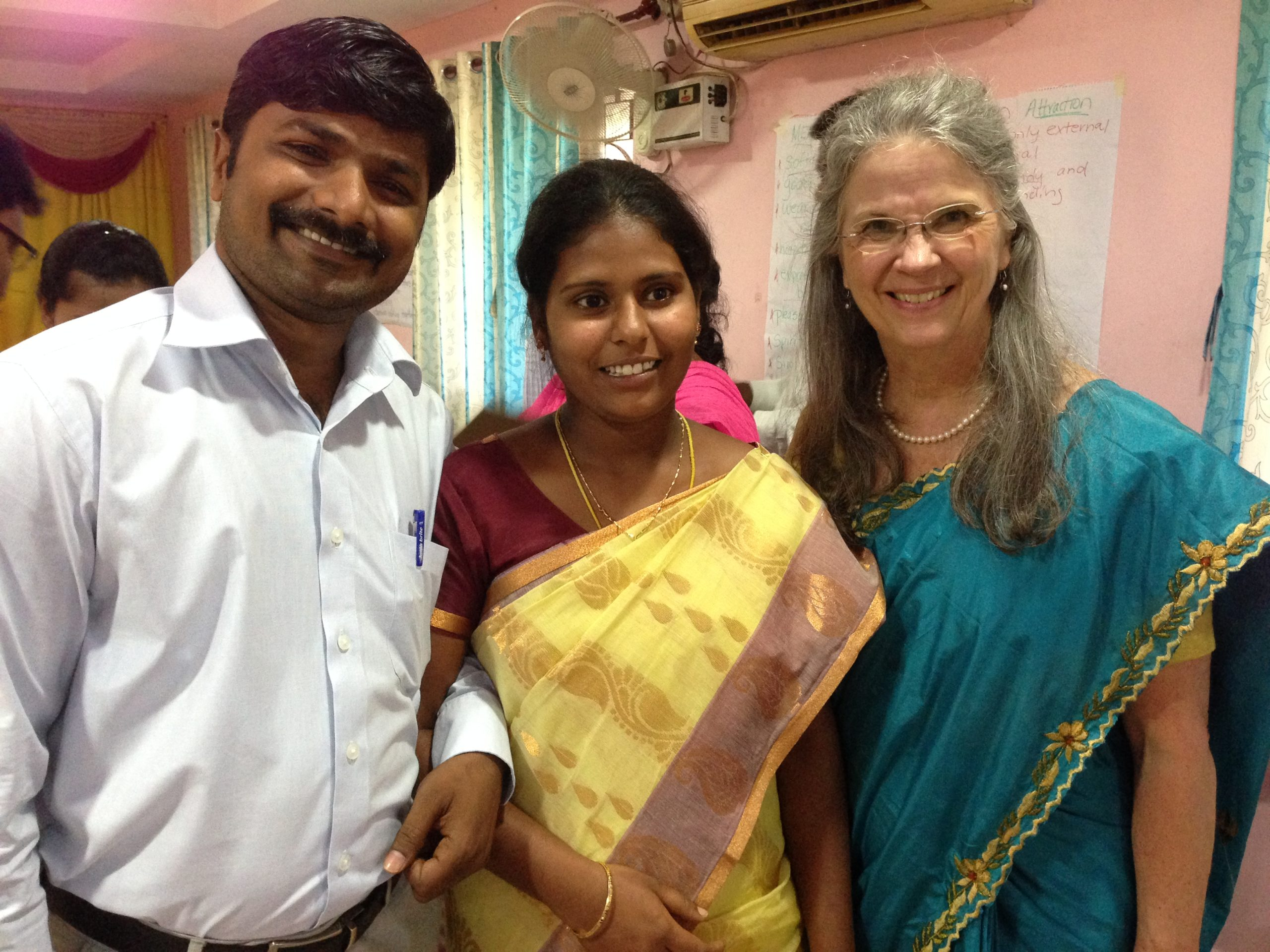 Debbie Dortzbach of World Relief with a couple in India who participated in the Families for Life Training.