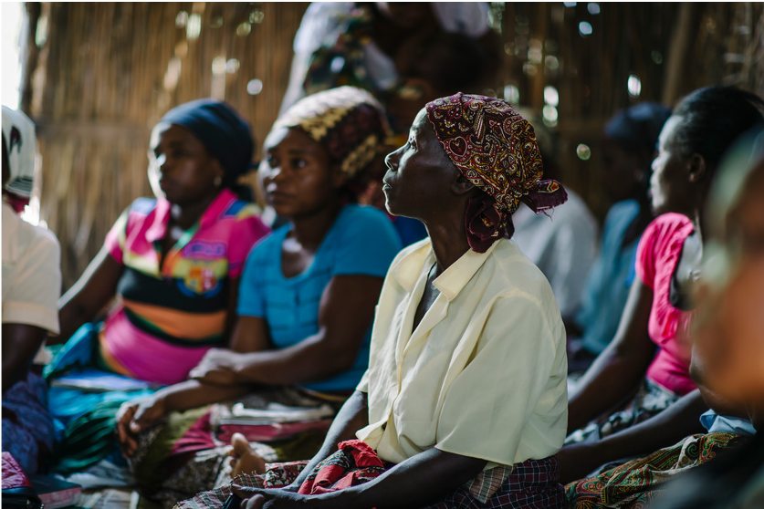 A group of women learn about TB and other health issues in a Care Group Meeting in Mozambique.