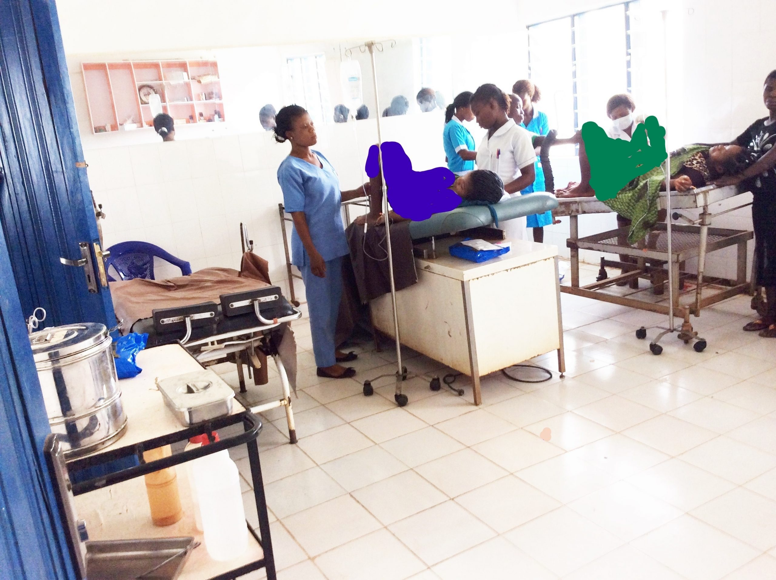 Health workers attend to patients in a maternity ward in Nigeria.