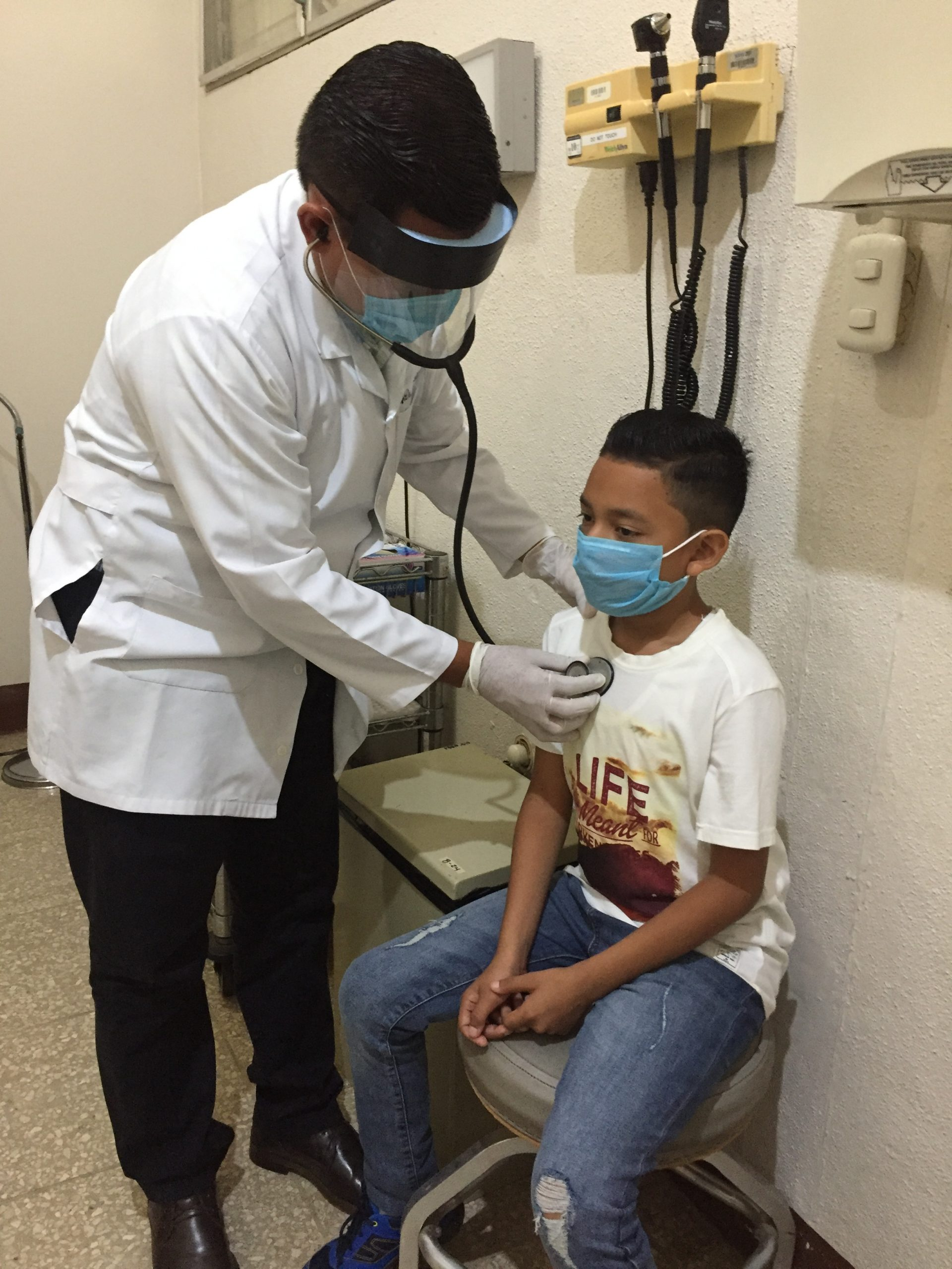 A doctor listens to the heart of a young patient at the Samaritan Clinic in Nicaragua.