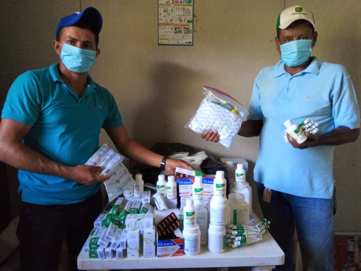 Health Promoters in Sabalete, Nicaragua display medicine, cleaning supplies, and personal protective equipment.