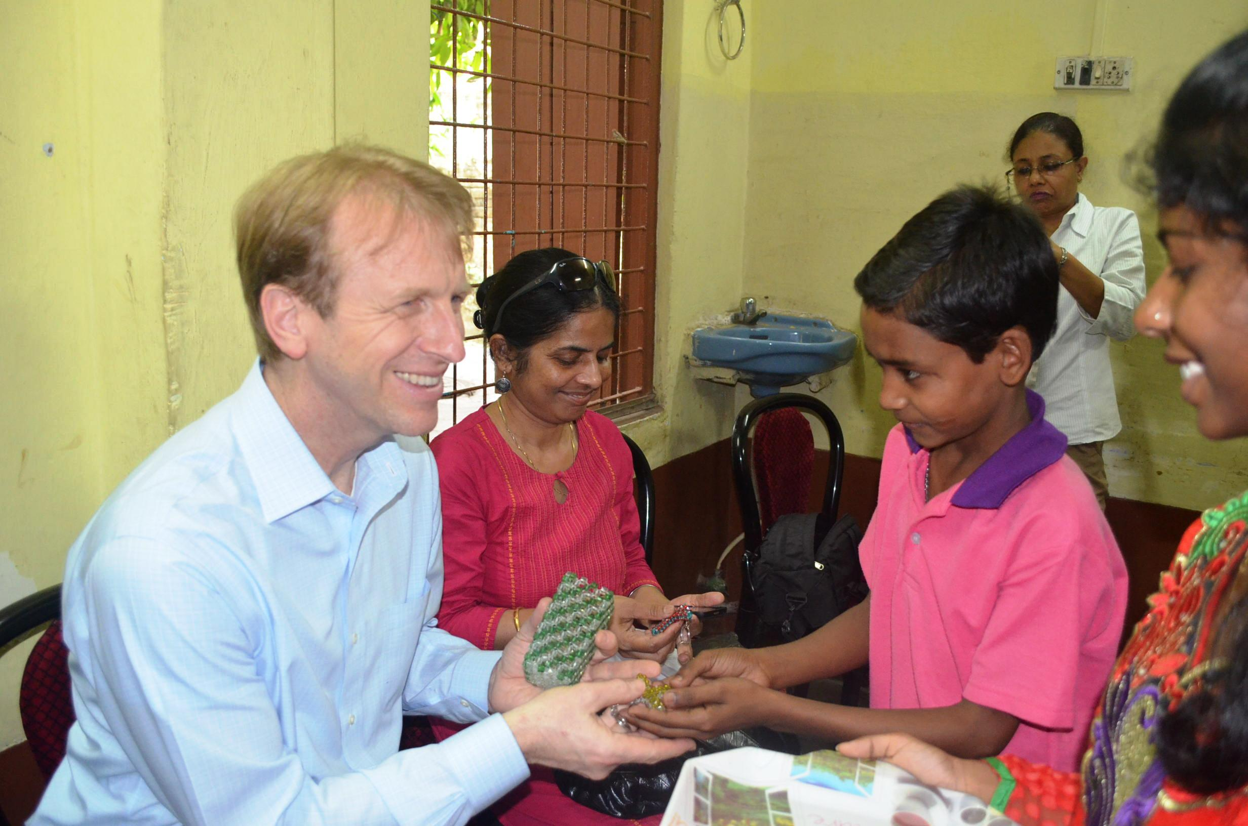 Daniel Speckhard, President & CEO of Lutheran World Relief and IMA World Health, with children at the Arunima Hospice, a care facility for people with HIV/AIDs and children whose parents have HIV/AIDs that is affiliated with the Episcopal Diocese of Kolkota, India.