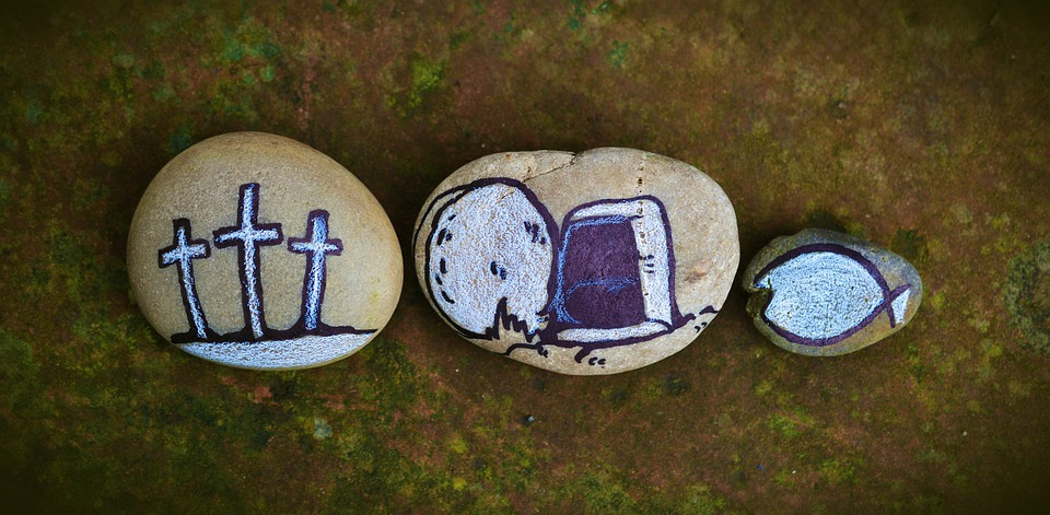 Three stones with paintings of three crosses, the open tomb and the symbol of early Christianity