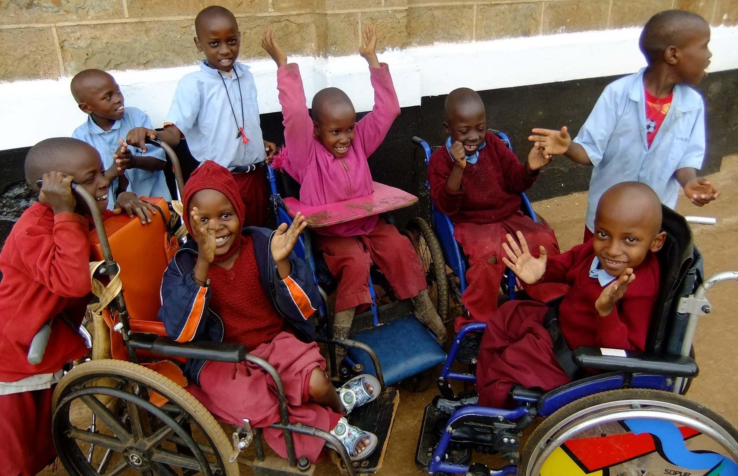 Happy children in wheelchairs