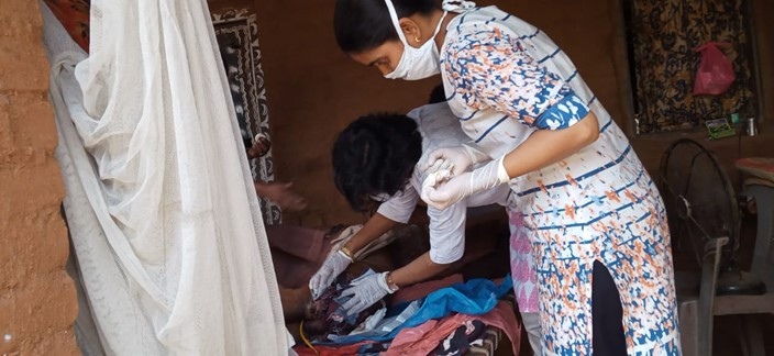 Doctor and nurse treat a patient in India