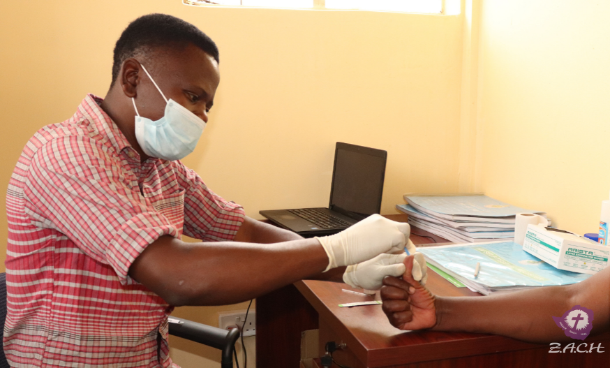 A man at a health post in Zimbabwe performs HIV testing.