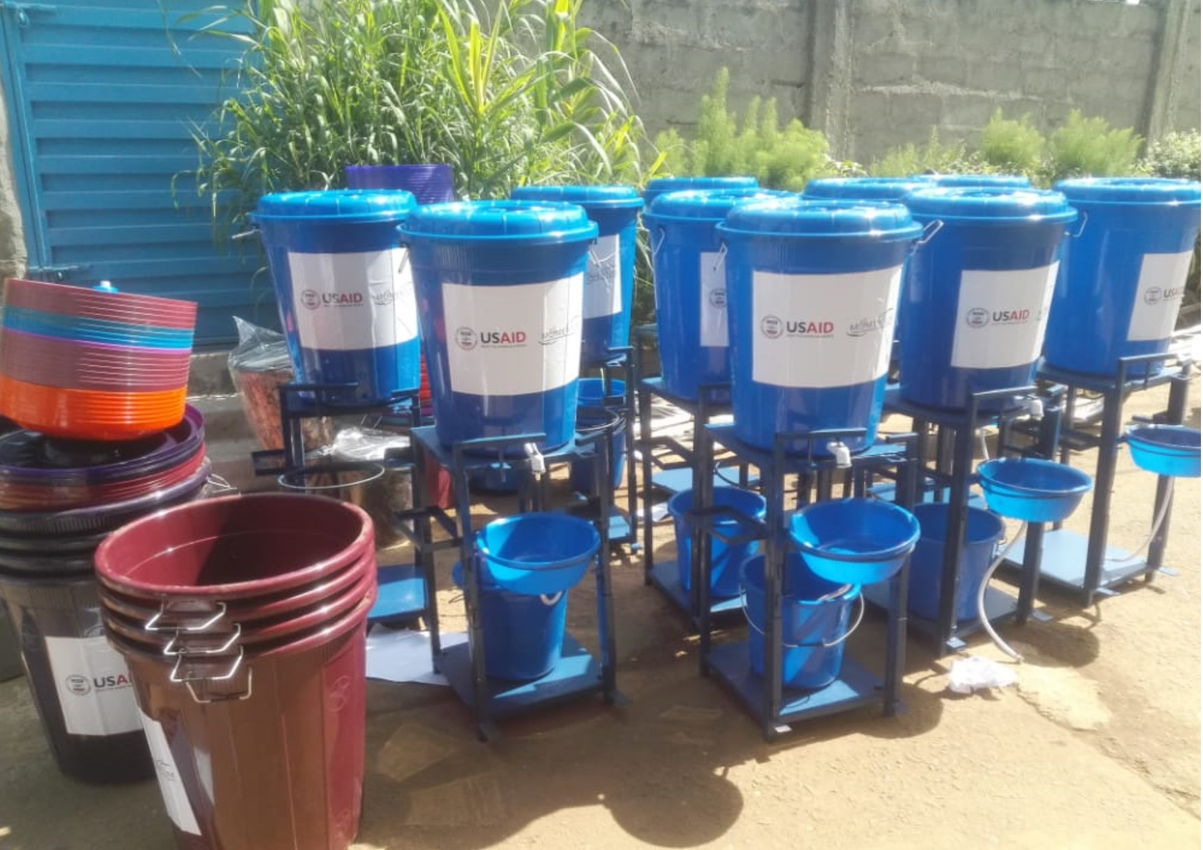Blue Water containers for sanitization sit ready to be distributed throughout Sierra Leone.