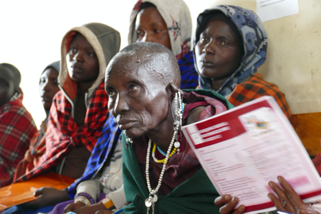 A woman who is a traditional birth attendant is surrounded by other women in Tanzania
