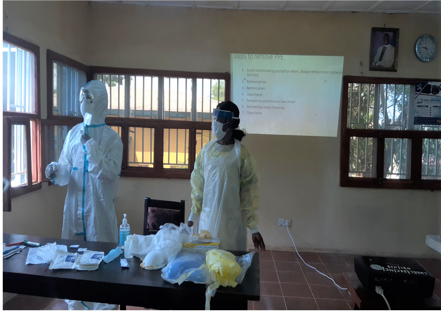 Health workers in Sierra Leone put on personal protective equipment, such as masks.