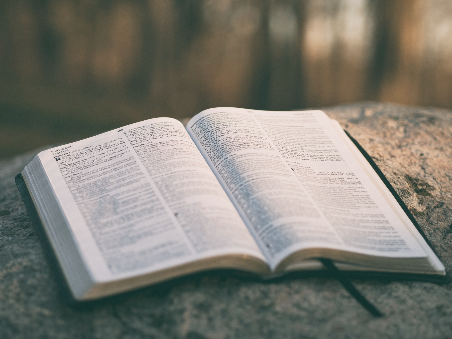 A bible sits on a table.